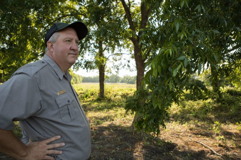James Oliver, landscape architect with the National Parks Service, gives a tour of the San Juan Acequia and the mission's demonstration gardens.