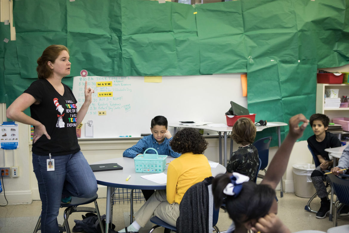 """Andrea Lucas, SAISD's Lamar Elementary School fourth grade teacher, works with her class during """"Tiger Time"""" next to covered walls in preparation for STAAR testing."""