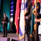 Mayor Ron Nirenberg presents the flags of San Antonio's Sister Cities.
