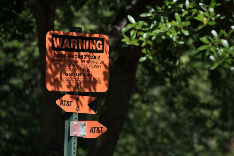 Signs mark underground cabling in Olmos Park neighborhood.