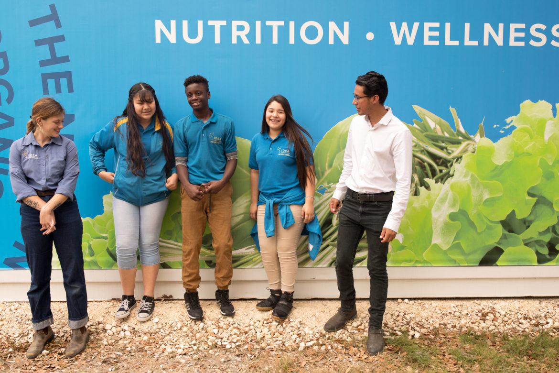 (from left) IDEA farm coordinator Cecile Parish, Briana Perez, David Jones, Laila Rodriguez, and CNP Farm Manager Hernan Colmenero stand for a photo outside the container.