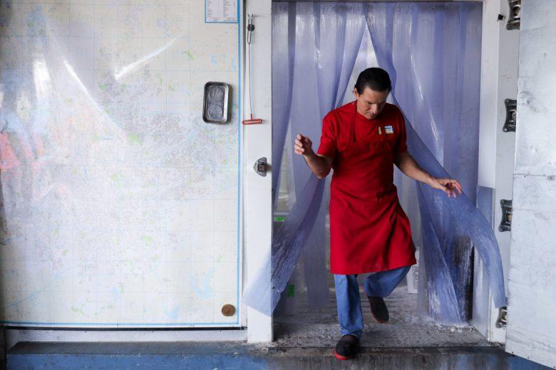 Las Nieves employee Edgar Coronado emerges from the walk-in freezer.