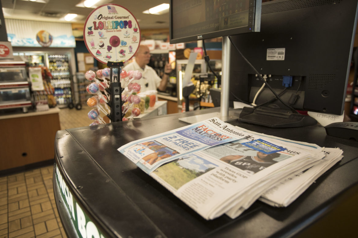 A copy of the San Antonio Express News' Saturday edition for sale at a gas station.