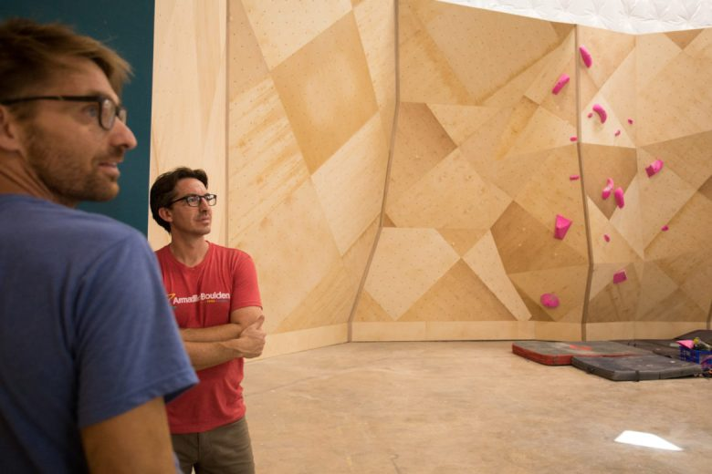 (From left) Joe Kreidel and Michael Cano, Armadillo Boulders co-owners, give a tour of the facility.