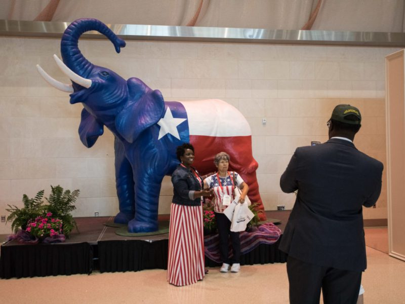 Attendees pose in front of the Republican elephant statue.