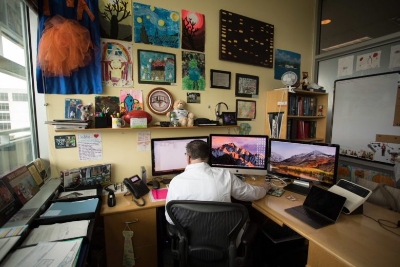UT Health San Antonio Pediatric Oncologist Gregory Aune works in his office at the Greehey Children's Cancer Research Institute.