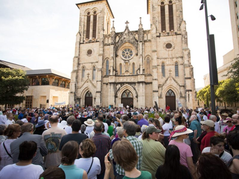 Prayers and moments of silence were held in Main Plaza as hundreds gathered for a vigil in honor of families separated at the U.S.-Mexico border.