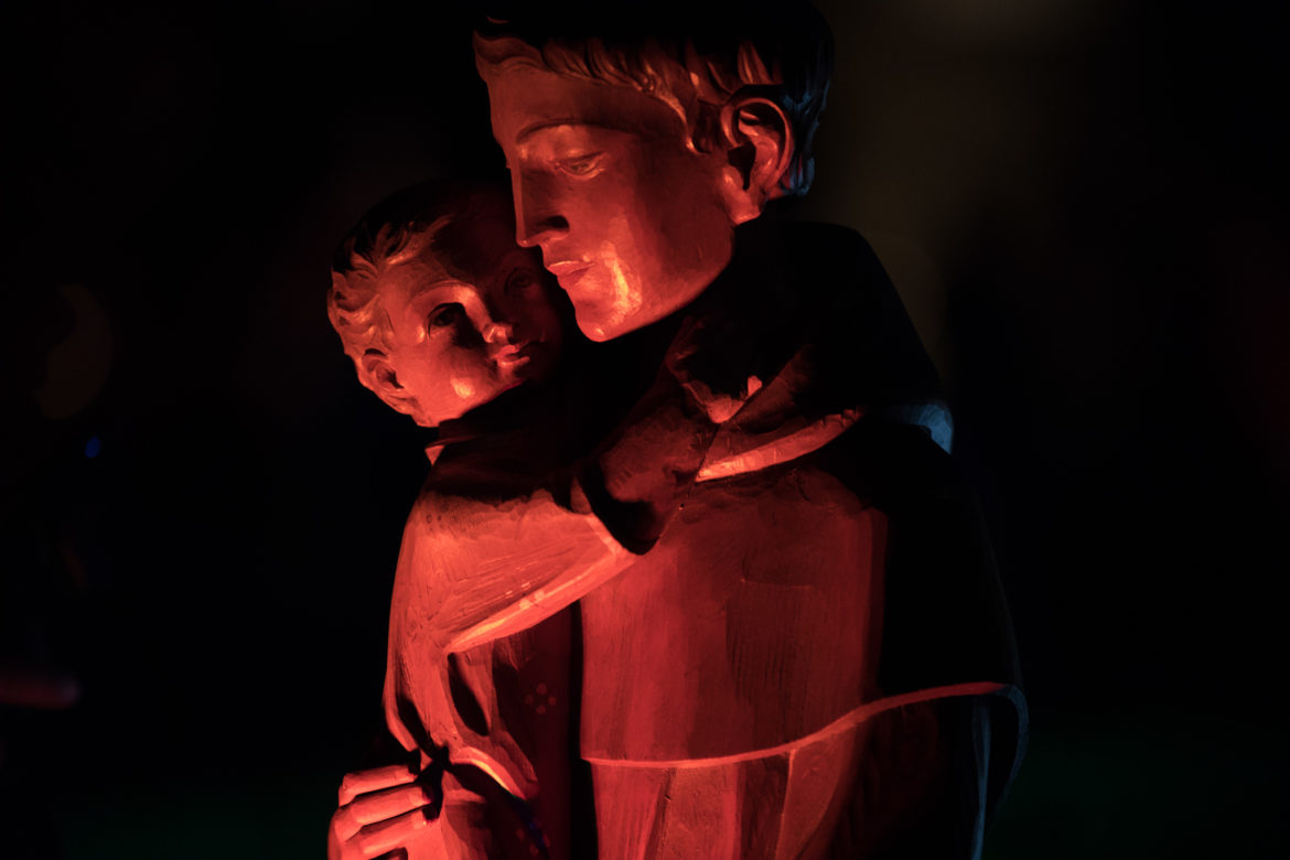 A statue of St. Anthony, depicted with the Christ child, from St. Anthony Catholic High School is on display on the barge.