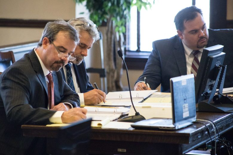 (From left) Darin Darby and Philip Marzec, SAISD attorneys, and Joe Hoffer, representing Democracy Prep, write down notes as Alejandra Lopez takes the stand.