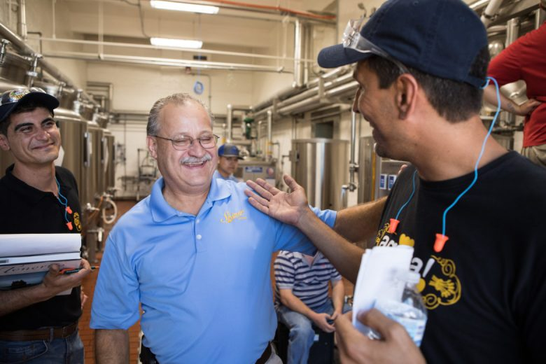 (From left) Pedro Baussou, founder and owner of Agüita Cerveza Artesanal, Shiner Brewmaster Jimmy Mauric, and Enrique Arocas, founder and owner of Agüita Cerveza Artesanal, share a laugh while talking about their beer collaboration: Las Canarias Rubia.
