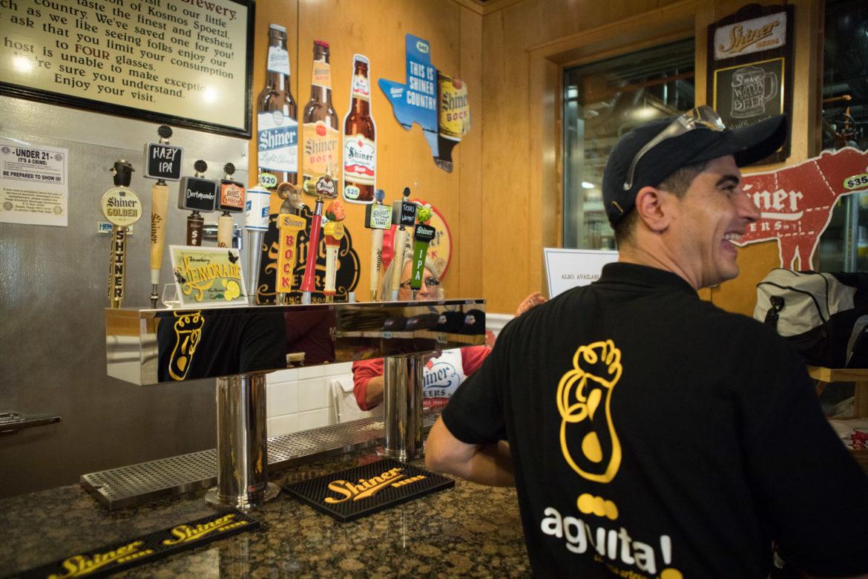 Pedro Baussou, founder and owner of Agüita Cerveza Artesanal, samples variations of Shiner beer.
