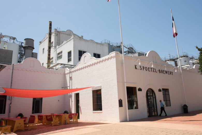 A man walks into the entrance of Spoetzl Brewery.