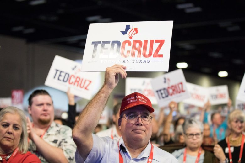 Attendees hold signs supporting Ted Cruz.