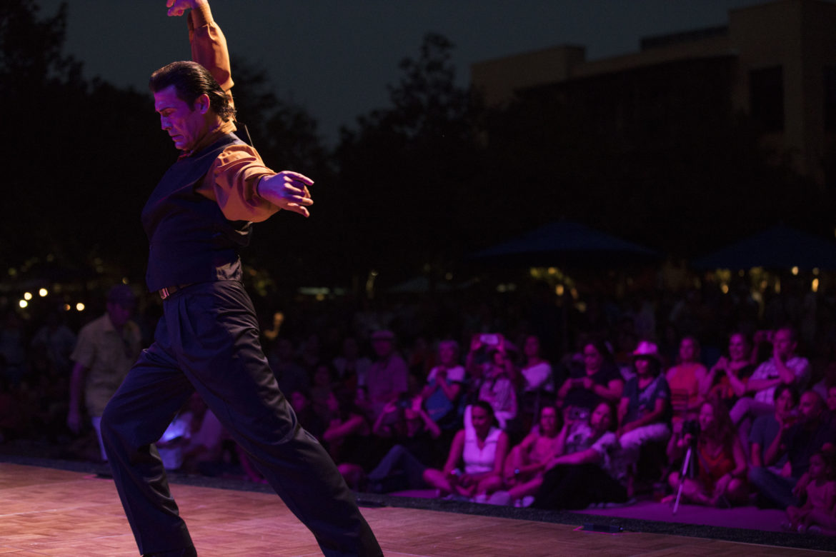 A Pure Flamenco dancer spins around in front of a crowd of hundreds at the Pearl.