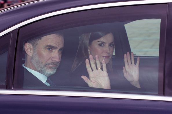 King Felipe of Spain and Queen Letizia of Spain wave from a car while attending a mass in El Escorial, Spain.