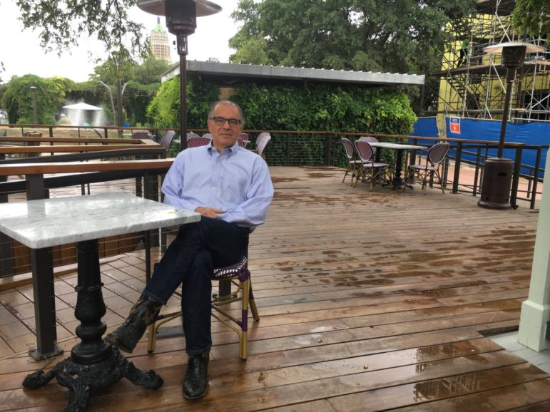 Hemisfair CEO Andres Andujar sits on a patio in Yanaguana Garden.