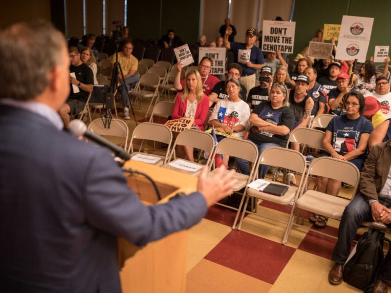 Alamo CEO Douglas McDonald attempts to talk down a crowd of citizens opposed to the revised Alamo master plan.