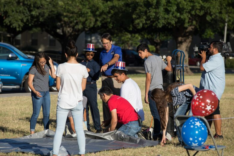 Students from the WEX Foundation work together to inflate the high altitude balloon.
