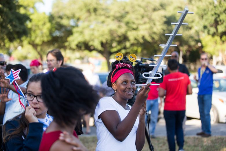 Mariama Diallo, 13, point an antenna to the balloon to track sensor data stored on the vessel.