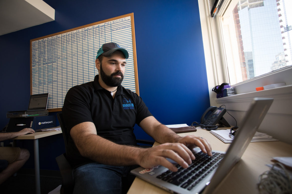 Braustin Mobile Homes co-founder Alberto Piña works in his office located in Geekdom.