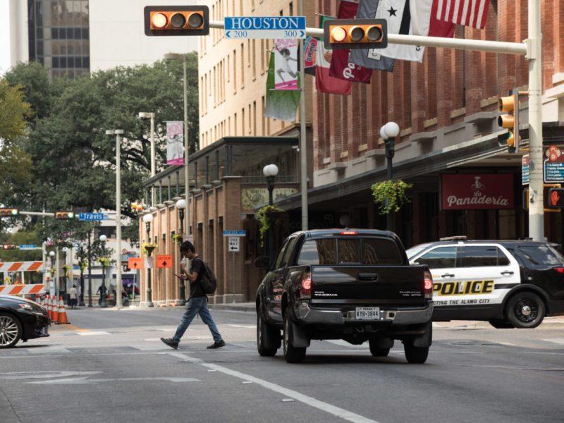 A man crosses Navarro Street at the East Houston Street intersection.