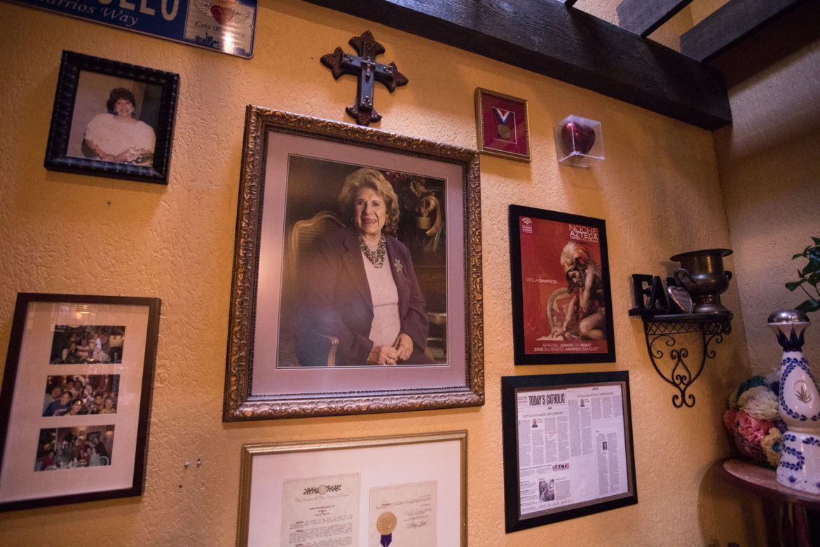 A framed photograph of Viola Barrios is displayed in the entryway of Los Barrios.