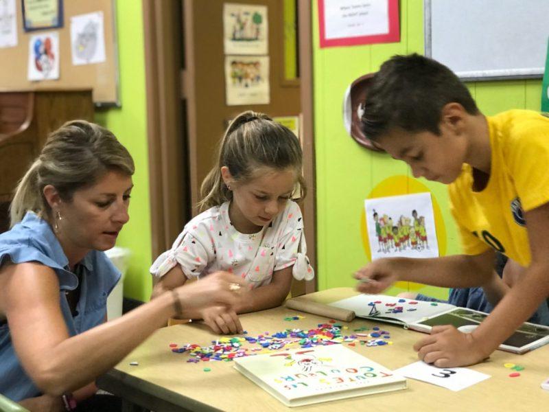 EstelleDe Oliveira works educating children using French immersion.