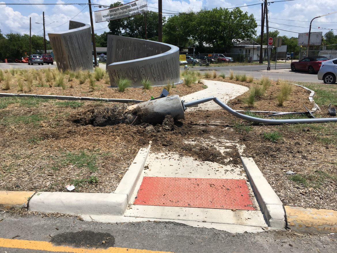 Within one week of the June 28 dedication of a new public sculpture near Elmendorf Lake Park, a vehicle evidently jumped the curb and damaged its installation site.