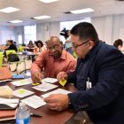 Gregory Rivers, Ball Academy, (left) and Dr. Hugo Saured work during a dual-language training session at the Pickett Academy Tuesday morning.