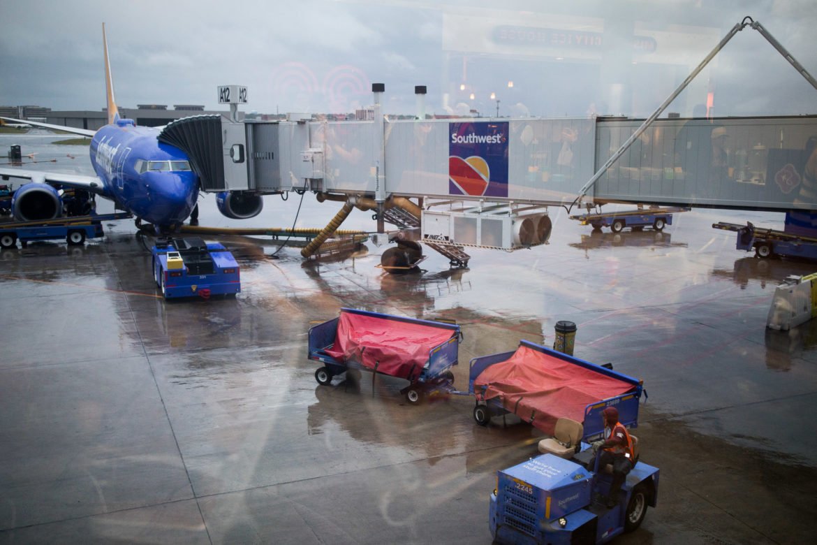 Southwest Airlines jets wait near gates at San Antonio International Airport.