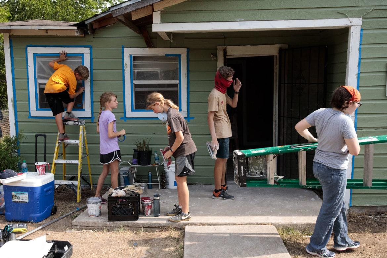 Volunteers at Blueprint Ministries begin working on Debra Clay's house in the Eastside of San Antonio.