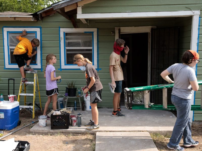 Volunteers at Blueprint Ministries begin working on Debra Clay's house in the Eastside of San Antonio.