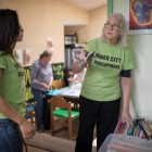 Patti Radle works with a volunteer at Inner City Development.