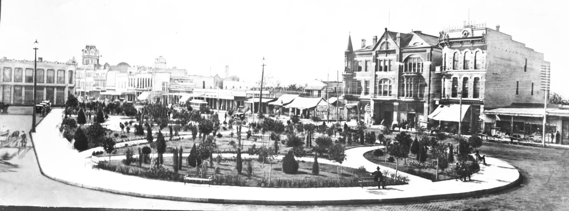 Small park on a former open dusty area of Alamo Plaza, circa 1890.