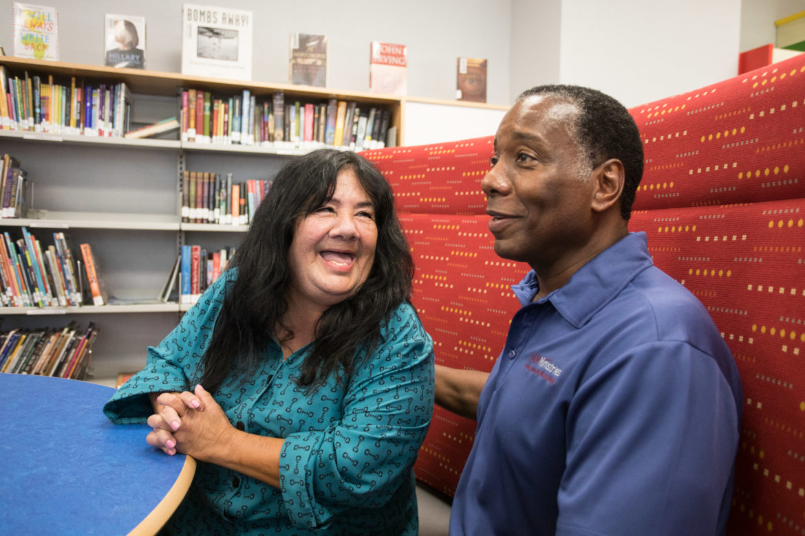 (From left) SAMMinistries client resident Lillie Espino and SAMMinistries CEO Navarra Williams share a laugh in the library.