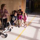 Carvajal Early Childhood Education Center teacher Andrea Greimel leads her students to the bathroom.
