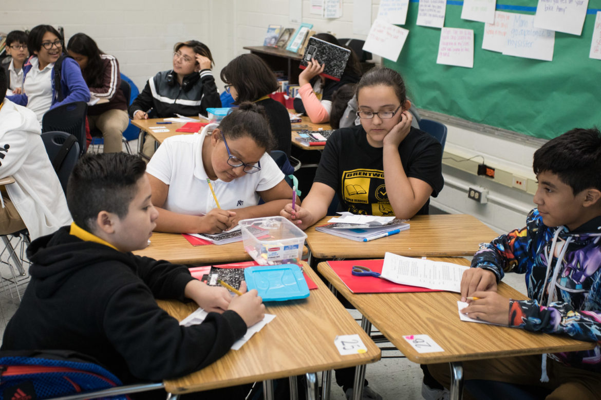 Brentwood Middle School students work together in teacher Megan Prado's seventh grade integrated reading and writing course.