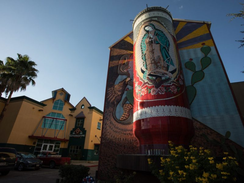 The Virgin of Guadalupe mural, in the form of a giant prayer candle, outside of the Guadalupe Theater.