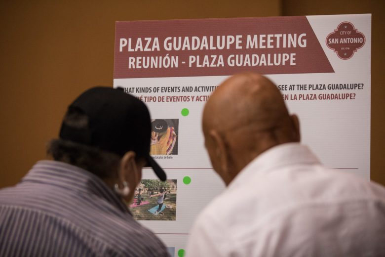 Meeting-goers place their colored stickers on the categories regarding what they love about Plaza Guadalupe.