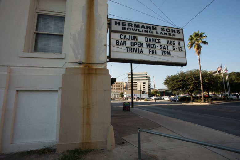 """The Hermann Sons Life Home Association Building marquee fronting St. Mary's Street just south of Nueva Street still reads """"Bowling Lanes."""""""