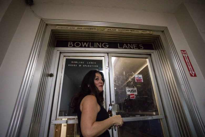 Lori McCorquodale Todd, Hermann Sons Life Home Association board member, unlocks the door to the bowling lanes.