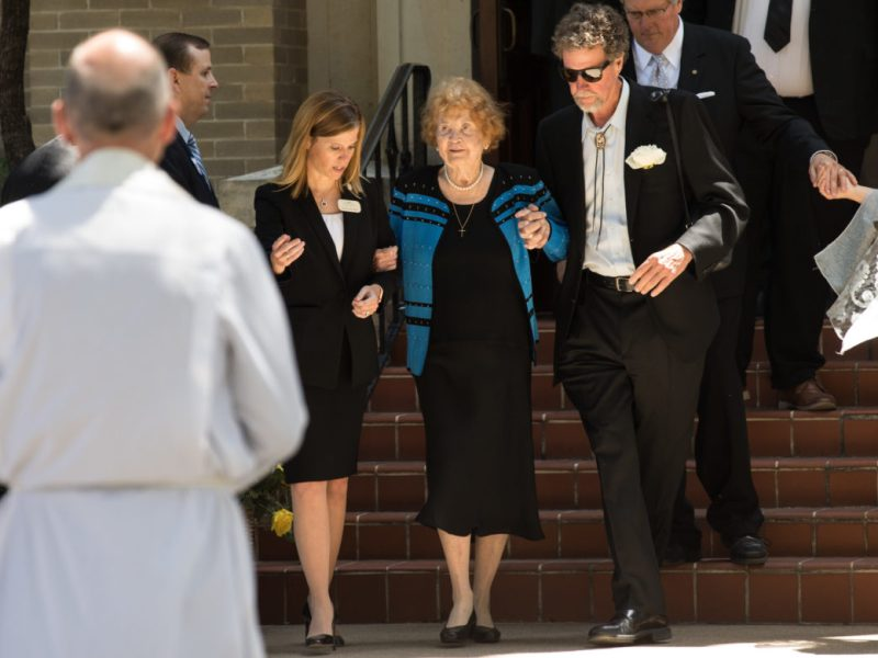 Pat Frost (center) is escorted by Helen Loring Dear (center left) and Thomas Frost III (right) towards Rev. Dr. Patrick Gahan outside of the church following the ceremony.