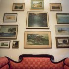 Julian Onderdonk paintings are displayed on the second floor of Villa Finale: Museum & Gardens.