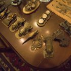 Victorian calling card holders are displayed on the table in one of the Green Rooms in Villa Finale: Museum & Gardens.
