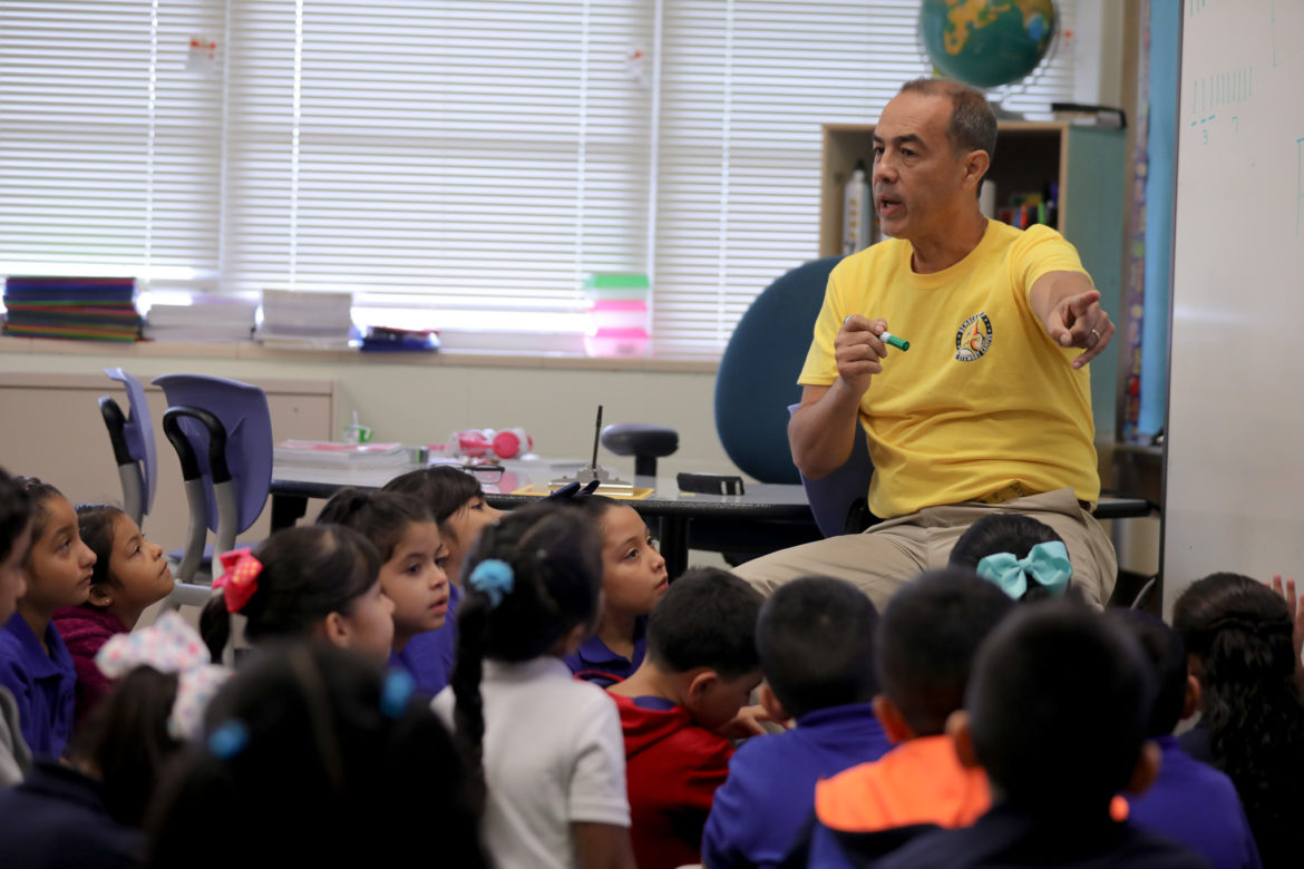 Jorge Triana, a second grade dual language teacher shares a lesson with children on their first day at Democracy Prep at Stewart Elementary.