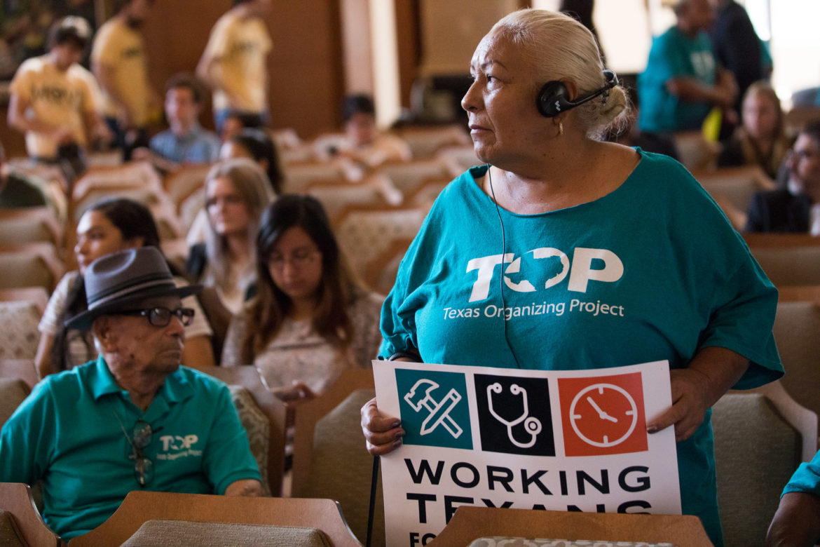 Merced Leyva with the Texas Organizing Project stands up following the affirmation of Paid Sick Leave ordinance will be addressed either by City Council or by election in November.