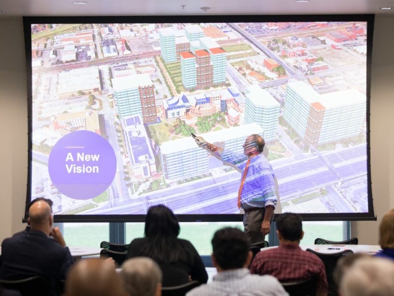 UTSA President Taylor Eighmy points to a rendering of the possible future of UTSA's Downtown Campus.