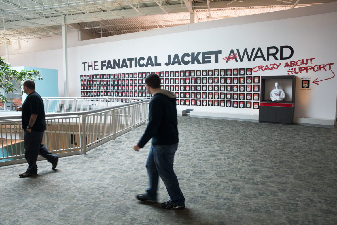 """Employees walk the corridors of the former Windsor Park Mall, now the Rackspace headquarters known as the """"The Castle."""""""