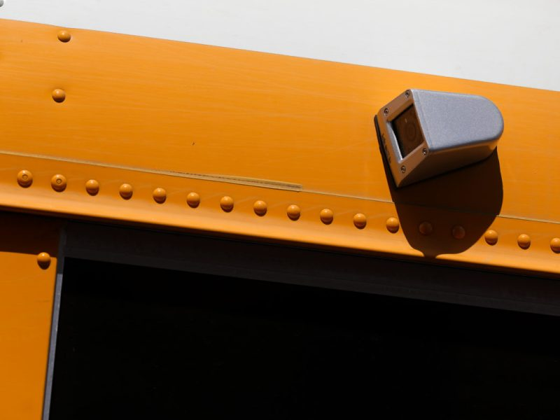 Side mounted cameras monitor the traffic and movement on the flanks of the school bus.