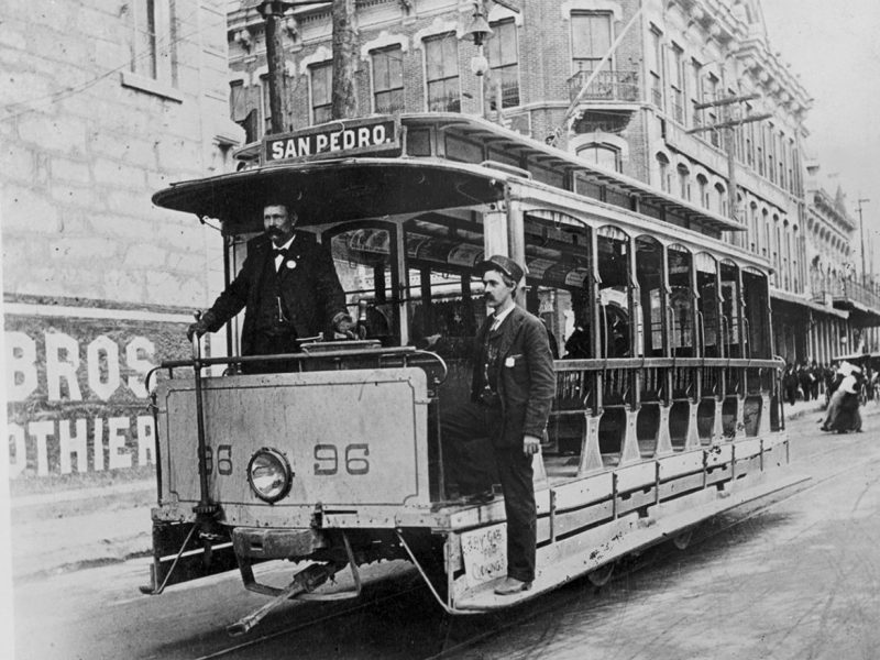 San Pedro Avenue streetcar going south on South Alamo Street near the intersection of East Commerce Street, early 1900s.